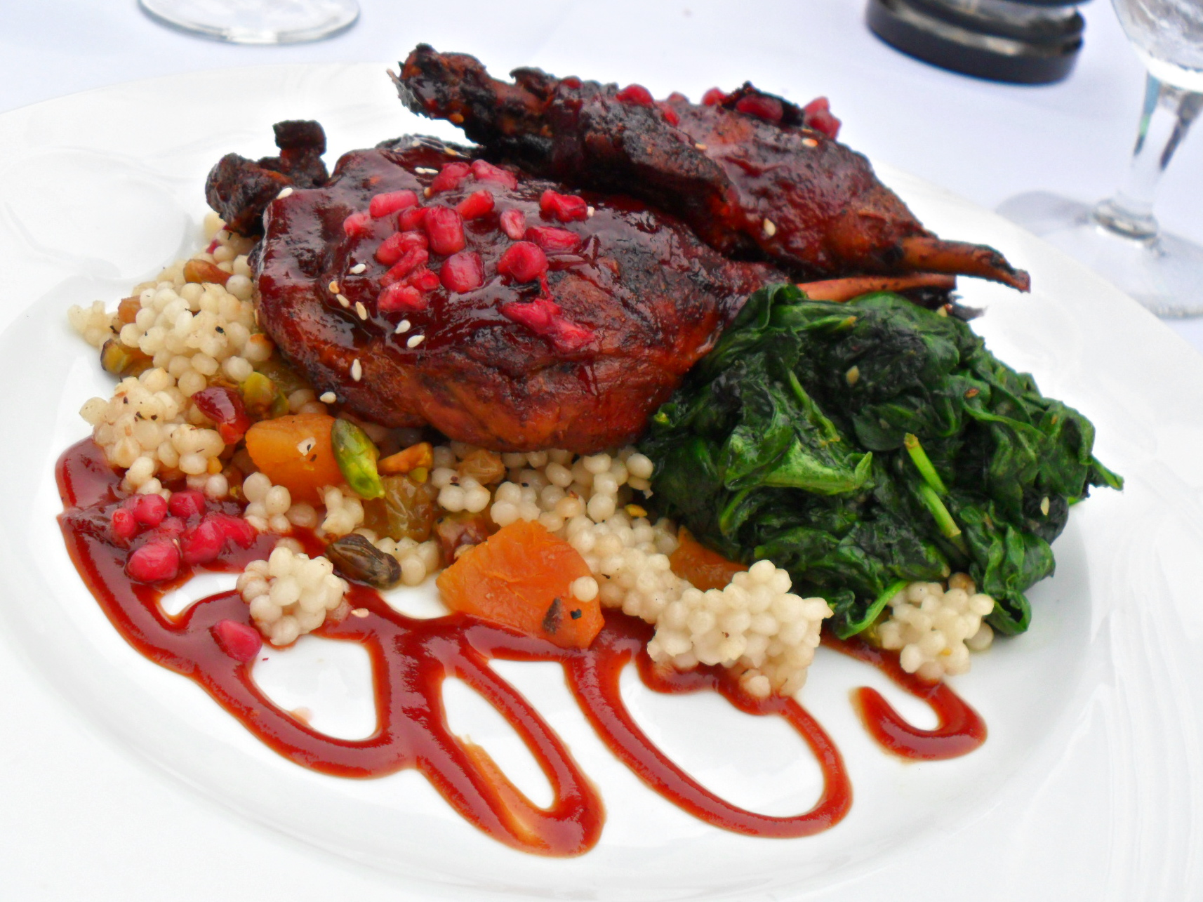 ... and pistachio couscous, spinach, and a pomegranate barbeque sauce