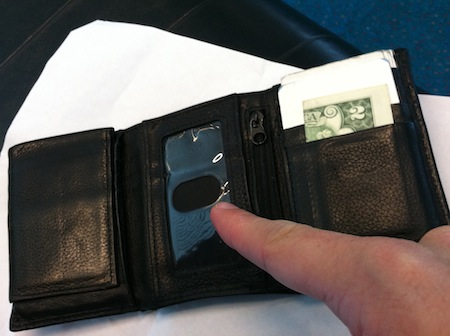 open wallet with missing driver's license and $2 bill