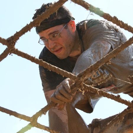 Climbing across a cargo net strung 10 feet off the ground.