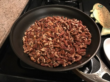 pecan-pieces-toasting-in-skillet